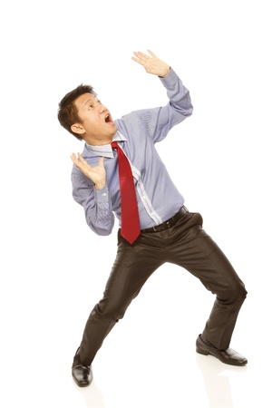 An employee looking up afraid of being crushed  isolated on white