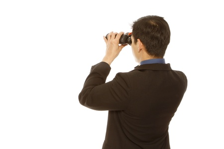 Rear view of a man in business attire using binoculars (on white)  photo