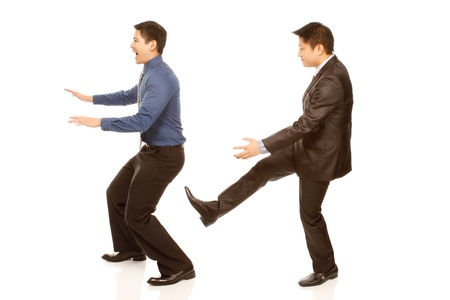 firing: A boss kicking out an employee (isolated on white)  Stock Photo