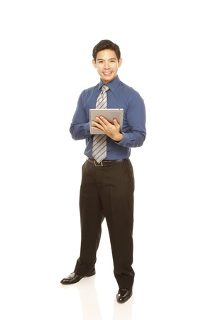 Man in shirt and tie using a tablet computer (isolated on white)