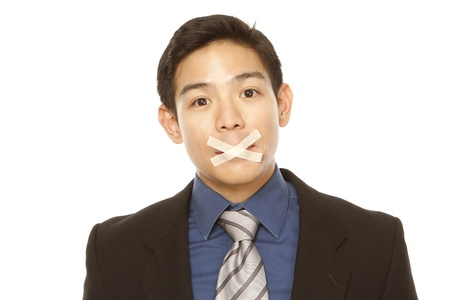 mouth closed: A businessman with tape over his mouth (isolated on white)  Stock Photo
