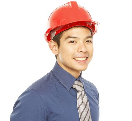 executive helmet: A man wearing a hard hat smiling at the camera (on white)