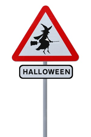 A halloween road sign with a flying witch silhouette (isolated on white)  photo