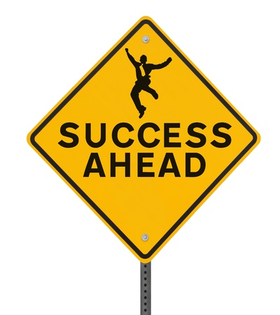 Success Ahead road sign with a silhouette of a man jumping  isolated on white photo