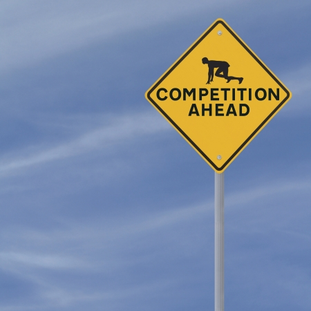 Road sign showing the silhouette of an athlete at the starting block ready for COMPETITION (against a blue sky background with copy space)  Stock Photo