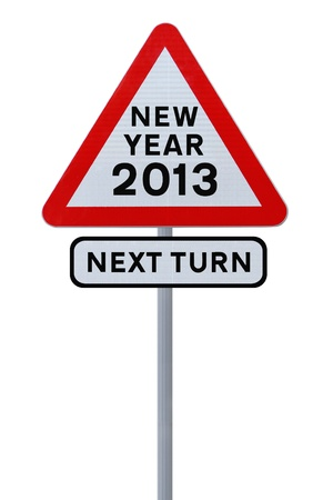 A road sign announcing the coming of the new year 2013  isolated on white   photo