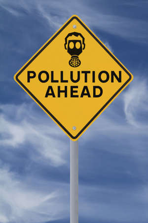 A road sign warning of pollution ahead  against a blue sky background Stock Photo - 14500981