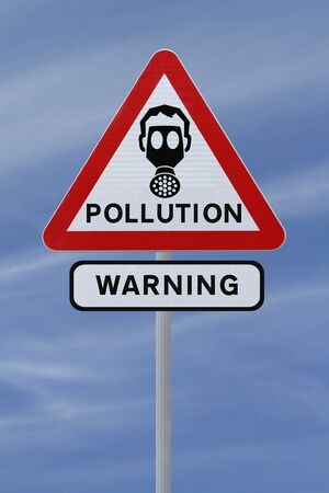 A road sign warning of pollution ahead  against a blue sky background   Stock Photo - 14500987