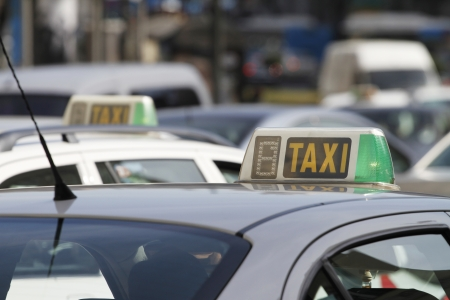 taxicabs: Taxicabs in Madrid, Spain (shallow depth of field)  Stock Photo