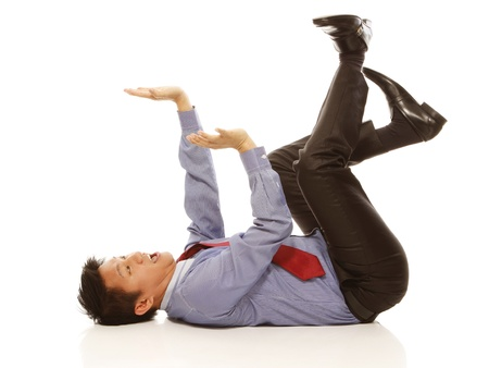 A man in shirt and tie acting afraid of being crushed on white background  Stock Photo