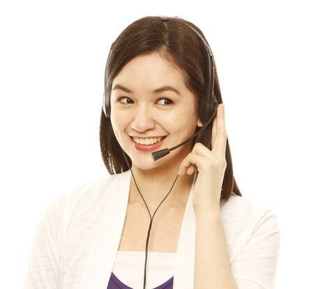 A smiling woman wearing a headset (isolated on white)  photo