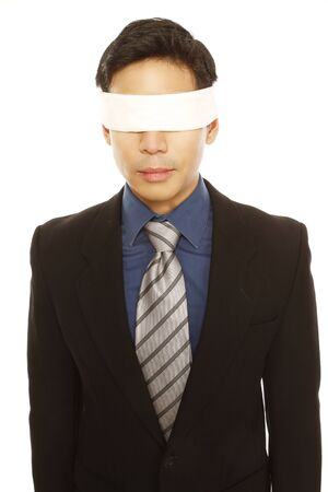 A blindfolded businessman  isolated on white   photo