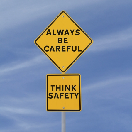 think safety: Road sign highlighting the importance of safety (against a blue sky background)