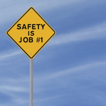 Road sign highlighting the importance of safety (against a blue sky background with copy space) Stock Photo - 14965864