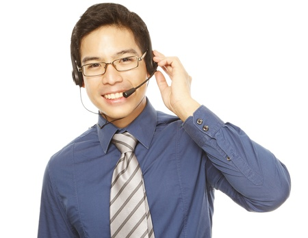 support agent: A smiling young man wearing a headset (isolated on white)  Stock Photo