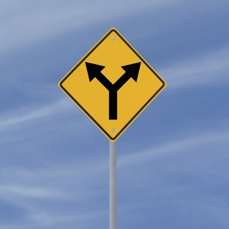 forked: Road sign indicating a forked road ahead (against a blue sky background)  Stock Photo
