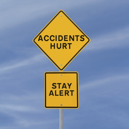 Road sign with a safety reminder against a blue sky background   photo