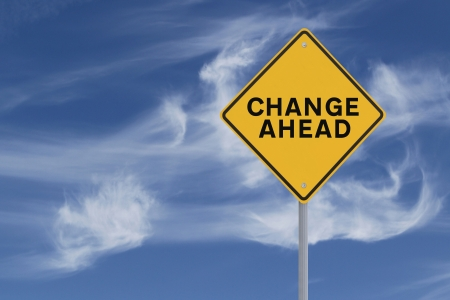 A road sign indicating change ahead against a dramatic sky background