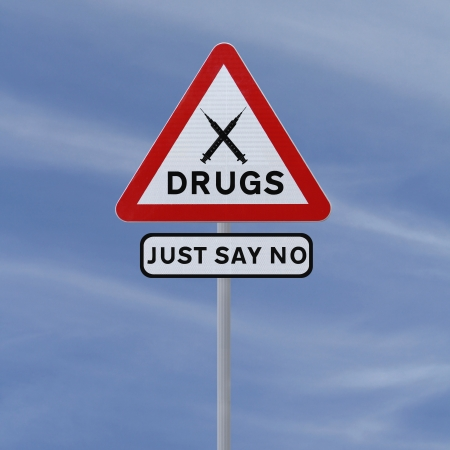 illegal substance: Road sign indicating Just Say No To Drugs (against a blue sky background)