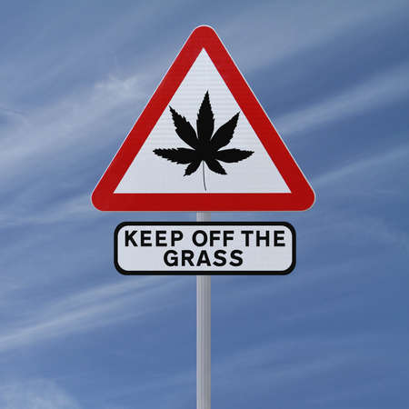 drug use: Warning sign on the use of marijuana (against a blue sky background)