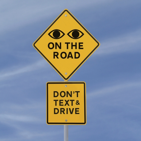 sms text: Road safety sign (against a blue sky background)
