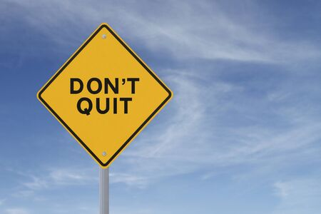 not give: Don t Quit road sign  against a blue sky background with copy space   Stock Photo