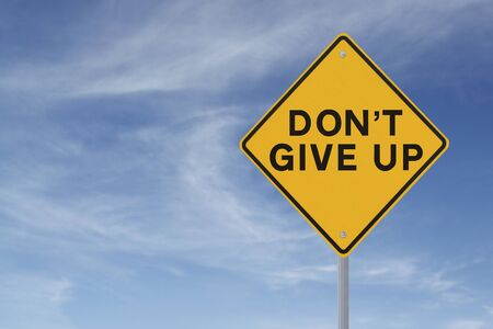 Don t Give Up road sign  against a blue sky background with copy space   Banco de Imagens