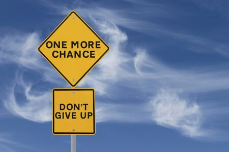 not give: Conceptual road sign on chances and not giving up  against a blue sky background with copy space   Stock Photo