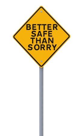 A road sign indicating a safety reminder or saying (isolated on white) applicable to workplace or road safety  photo