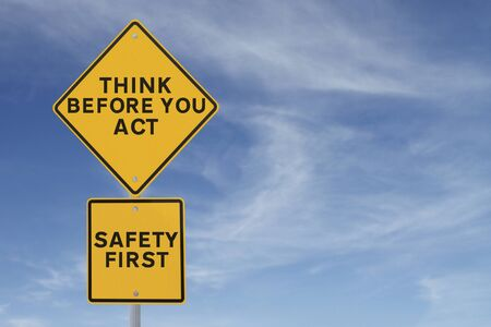 A road sign indicating a safety reminder or saying (against a blue sky background) applicable to workplace or road safety  Stock Photo - 15081924