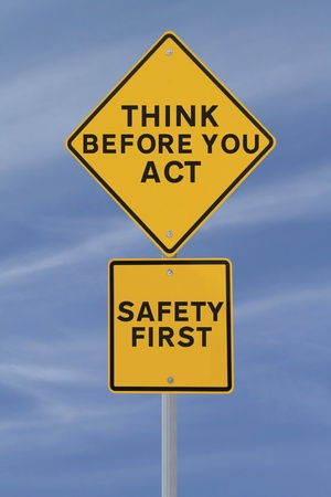 safety signs: A road sign indicating a safety reminder or saying (against a blue sky background) applicable to workplace or road safety