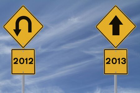 Conceptual road signs on the new year (against a blue sky background with copy space)  photo