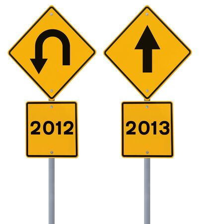 Conceptual road signs on the old and the new year (isolated on white)  photo