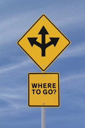 where to go: Conceptual road sign on choices or making decisions  against a blue sky background   Stock Photo