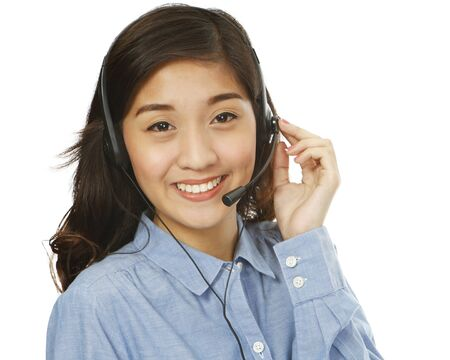 A young smiling woman wearing a headset  isolated on white   photo