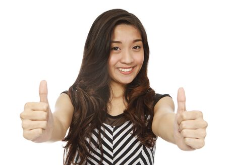 okay sign: A young woman signaling two thumbs up  isolated on white