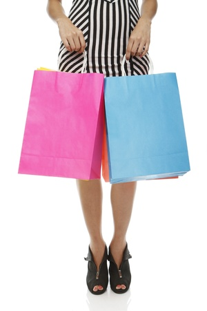 Colorful shopping bags held by a woman  isolated on white Stock Photo - 15332692