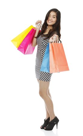 Full length shot of an attractive young woman holding paper shopping bags  isolated on white Stock Photo - 15335833