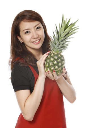Young woman holding a fresh pineapple fruit  on white background   Stock Photo - 15595340