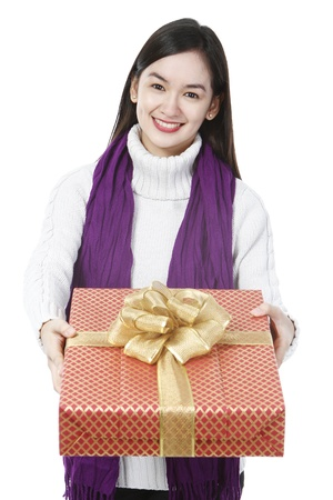 A young woman giving a present  on white background Stock Photo - 15595308