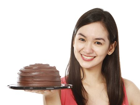 A young woman with a delicious chocolate cake  on white background   Stock Photo - 15595329