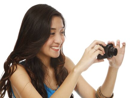 A young woman holding a point and shoot camera (on white)  photo