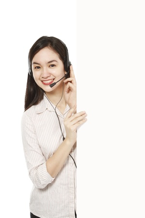 beside: A young woman wearing a headset beside a blank space  Stock Photo