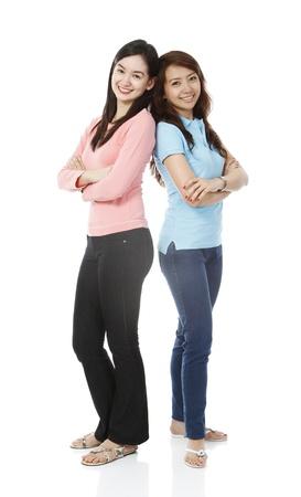 2 人の若い女性カジュアルな服を着てフルボディ ショット 写真素材