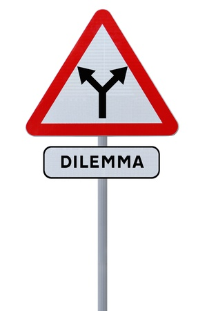 divided: A forked road sign implying choice or dilemma  Stock Photo