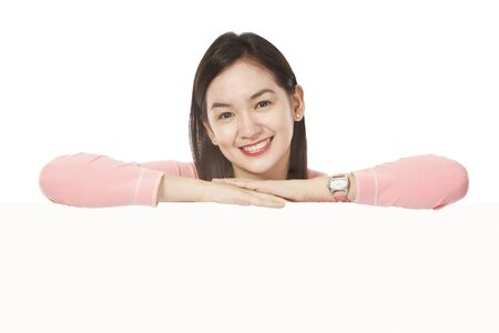 An attractive young woman above a blank space. (Watch accessory generic and unbranded.)  Stock Photo - 16622400
