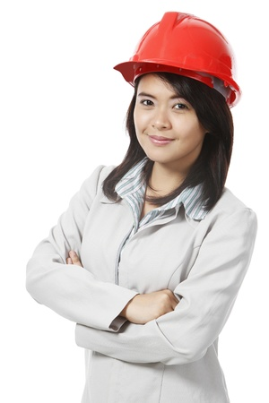 A young woman wearing a hardhat  on white
