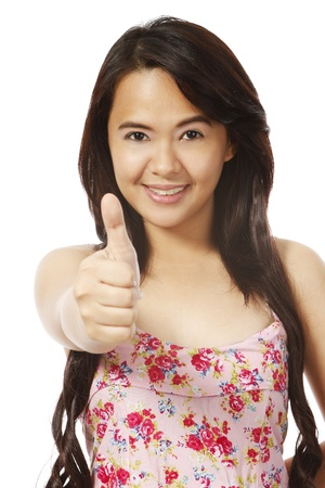 okay sign: A young woman doing a thumbs up sign (isolated on white)  Stock Photo