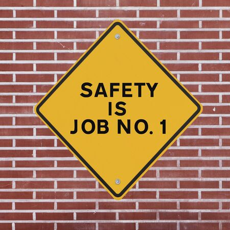 safety slogan: Workplace safety reminder on a red brick wall