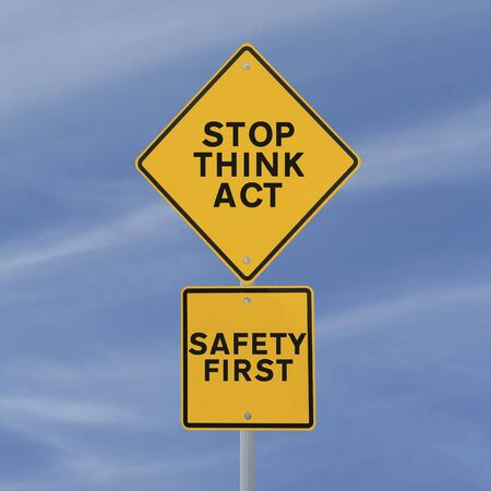 safety slogan: A safety road sign against a blue sky background  Stock Photo